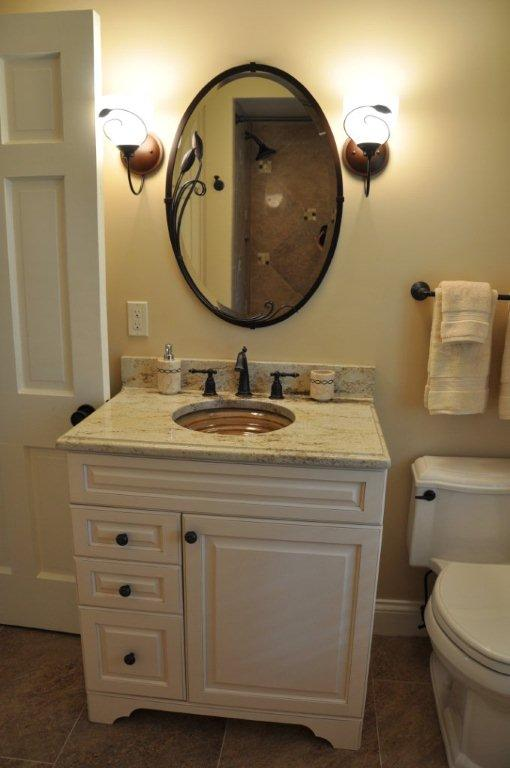 small stoneware pottery under mount powder room sink basin in tan glaze