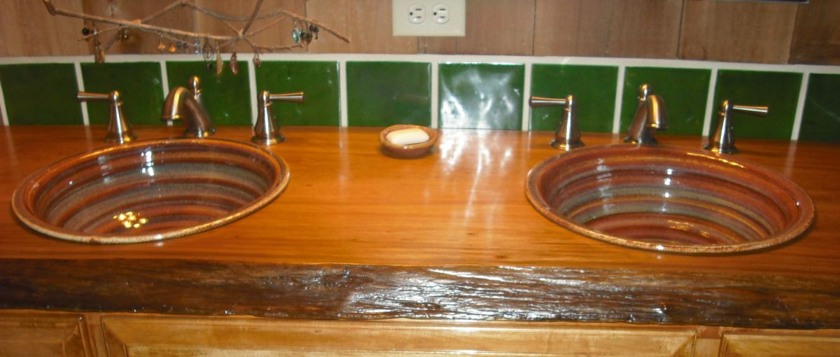 Pair of stoneware pottery self rimming drop in sinks in rustic setting