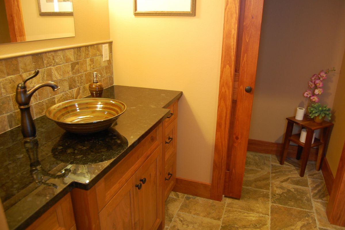 Rustic stoneware pottery vessel sink for log home