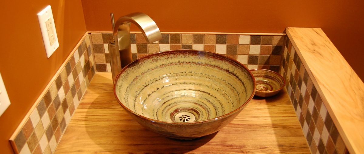 small stoneware pottery room sink basin in tan glaze